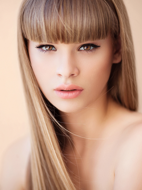 Outdoor shot of young beautiful woman. Professional make up and hair style.